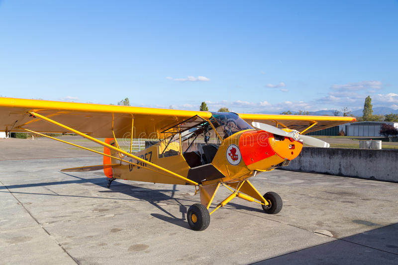 Classic yellow Piper Cub aircraft. Bremgarten, Germany - October 22, 2016: A classic yellow Piper Cub aircraft parked at the airport stock photo