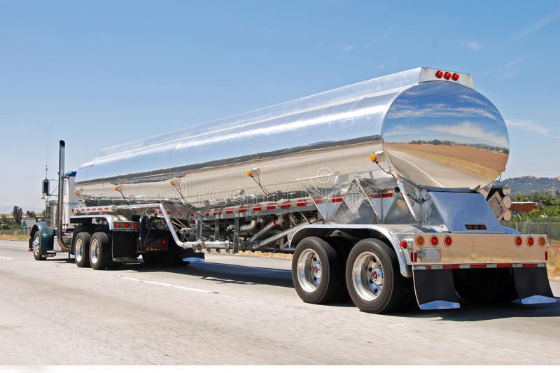 Classical american big vintage petrol truck. View of classical american big vintage petrol truck on the road in California stock image