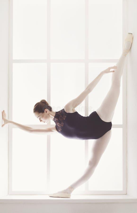 Classical Ballet dancer in split stock photography