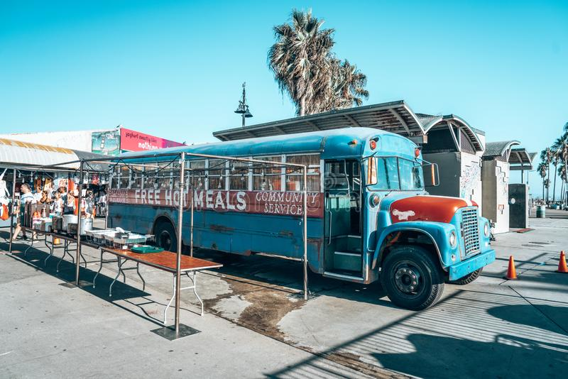 Classical bus serving food to homeless people at the Venice Beach. August 10, 2018. Los Angeles, USA. A commute classical bus serving food to homeless people at stock image