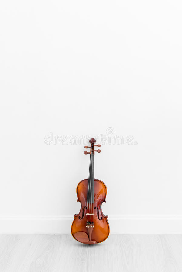 Classical cello on white wall background stock image
