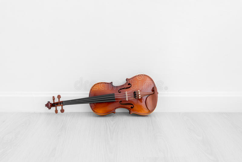 Classical cello on white wall background. With copy space stock photography