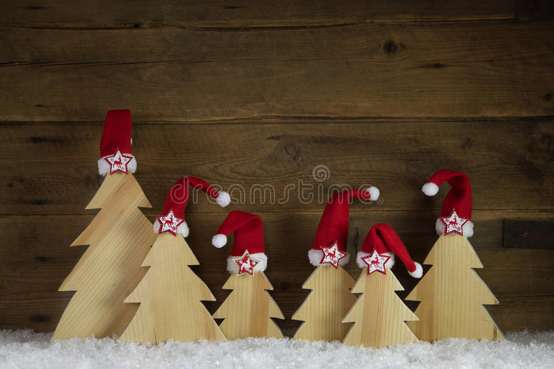Classical christmas card with santa hats in red, white and brown. Classical christmas greeting card with santa hats in red, white and brown colors stock photography
