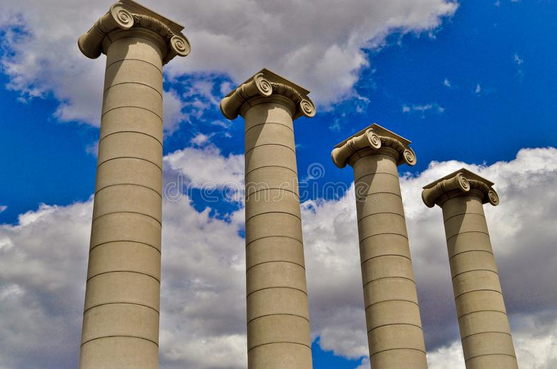 Classical columns under blue sky in Barcelona Spain. Building facade of Barcelona Spain. The Architecture of Barcelona shows a mixture of architectural styles in royalty free stock photography