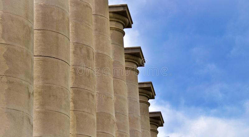 Classical columns under blue sky in Barcelona Spain stock photo