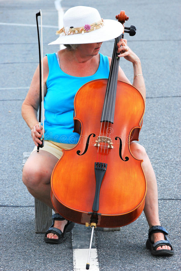 Classical concert. Female cellist performing a classical concert in the street stock photography