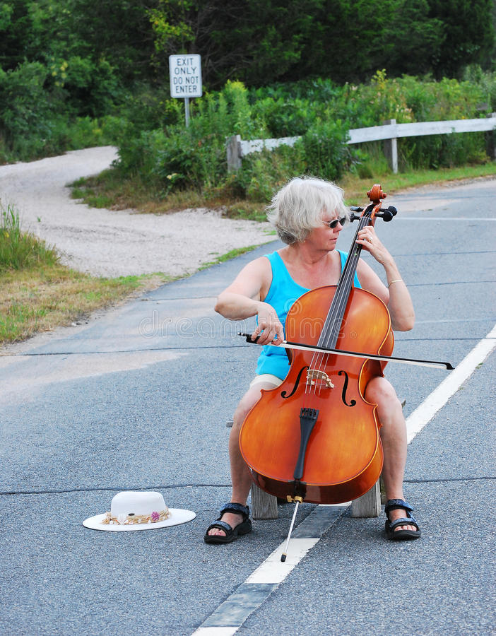 Classical concert. Female cellist performing a classical concert in the street royalty free stock photos