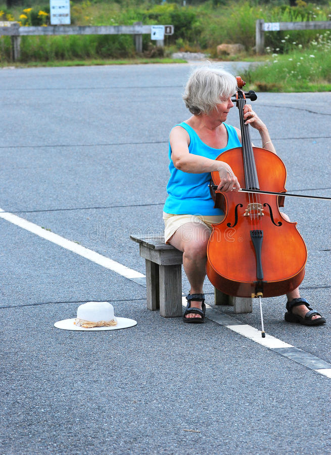 Classical concert. Female cellist performing a classical concert in the street stock photos