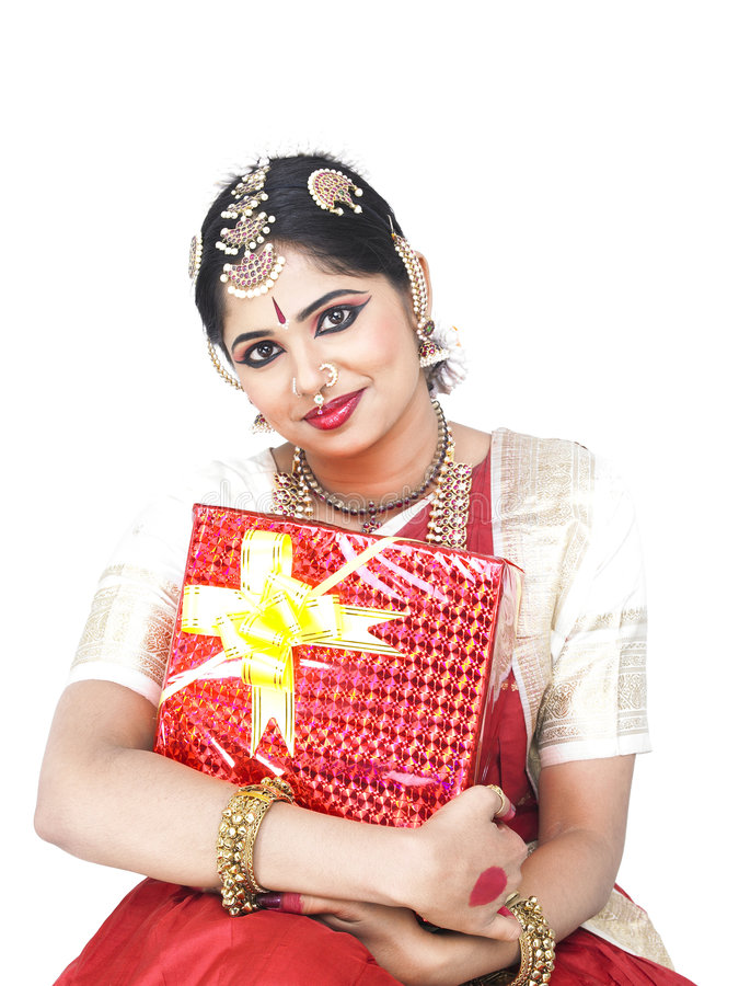 Classical dancer with a gift box. Beautiful female Bharathanatyam dancer from india with a gift box stock images