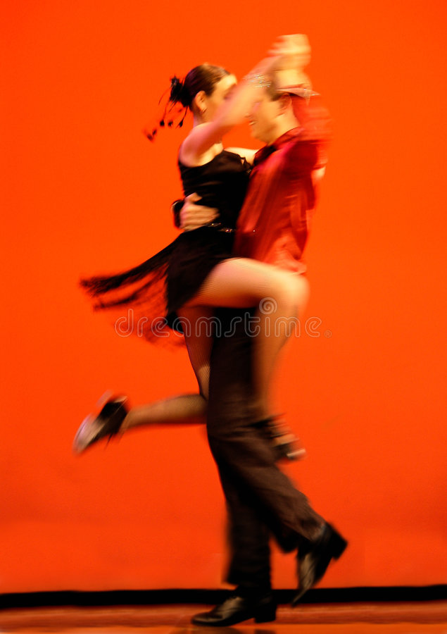 Classical Dancers. On red background stock image
