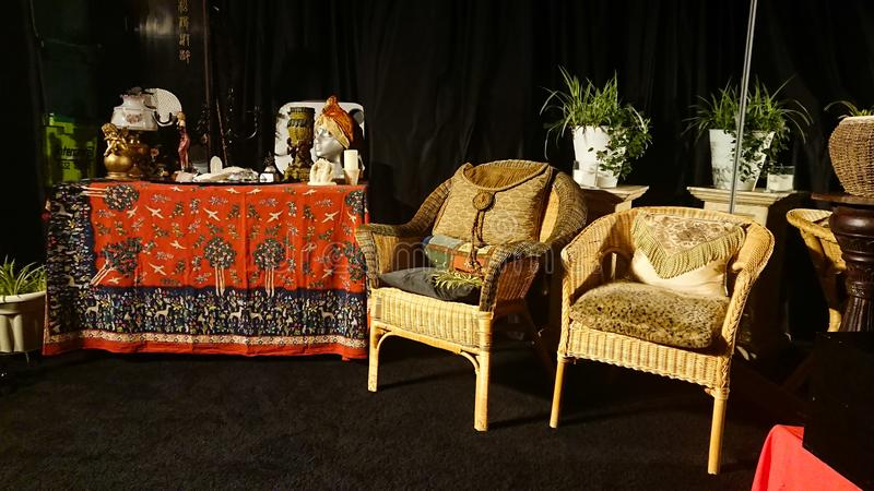 Classical english style furniture. A selection of classic furniture displayed with a dark background. Visible two chairs dating from 1930`s and a medium sized royalty free stock images
