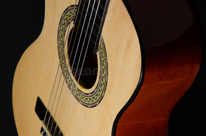 Classical guitar on a black background stock photo