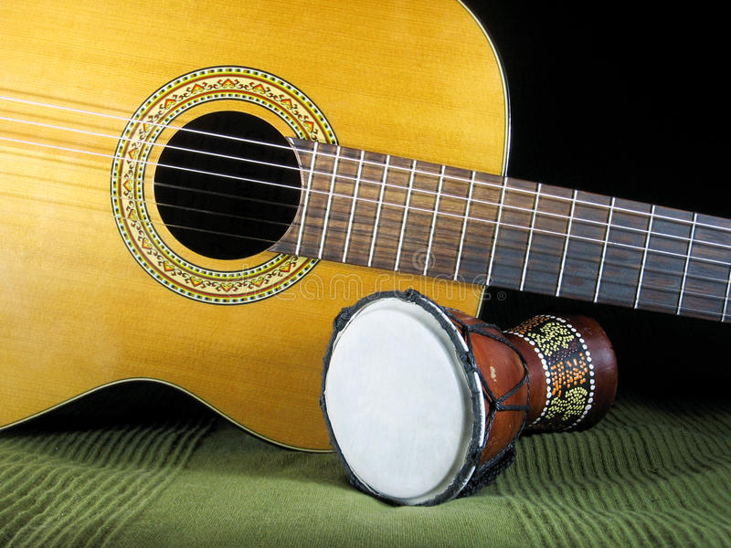 Classical guitar and hand drum. Classical 6-string acoustic guitar and hand drum royalty free stock images