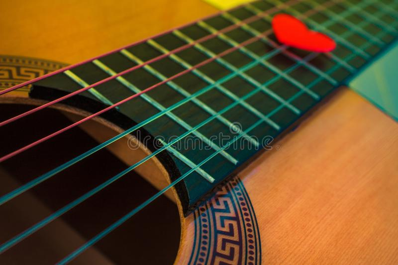 Guitar with guitar pick. Classical guitar with guitar pick royalty free stock photo