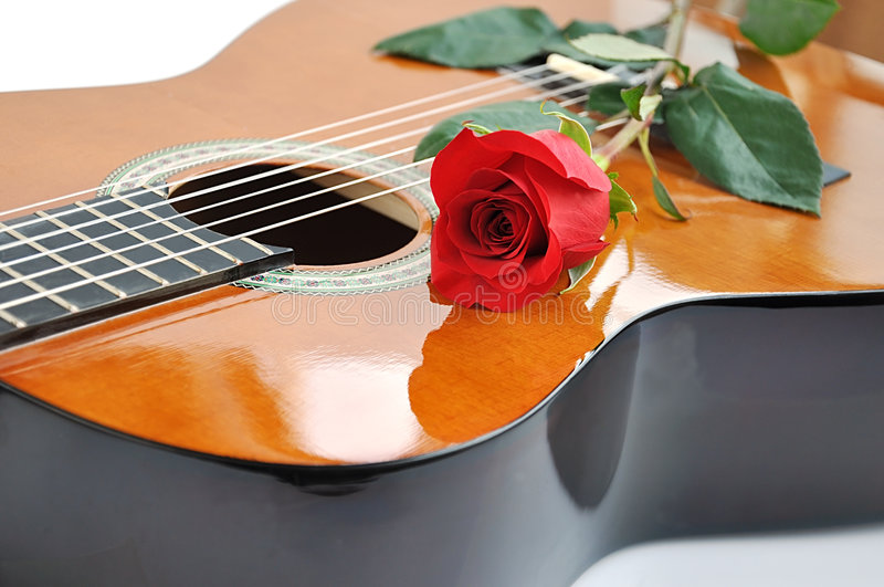 Classical guitar and rose. stock image