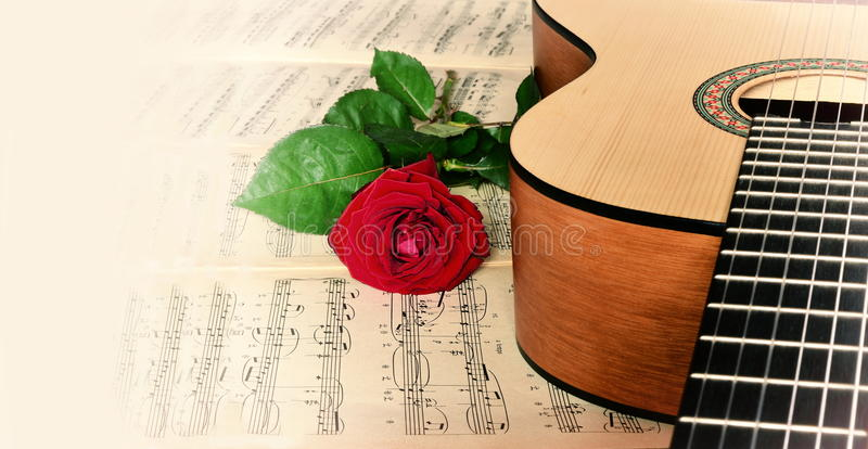 Classical guitar and rose. Classical guitar and red rose and notes stock image