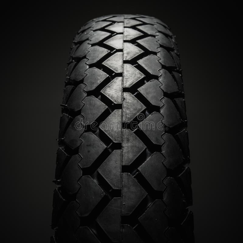 Classical motorcycle tire. Close-up shot of classical motorcycle tire tread royalty free stock photo