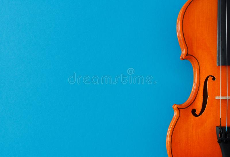 Classical music concert poster with orange color violin on blue background with copy space stock images