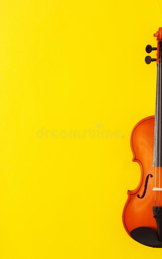Classical music concert poster with orange color violin on yellow background with copy space royalty free stock photography
