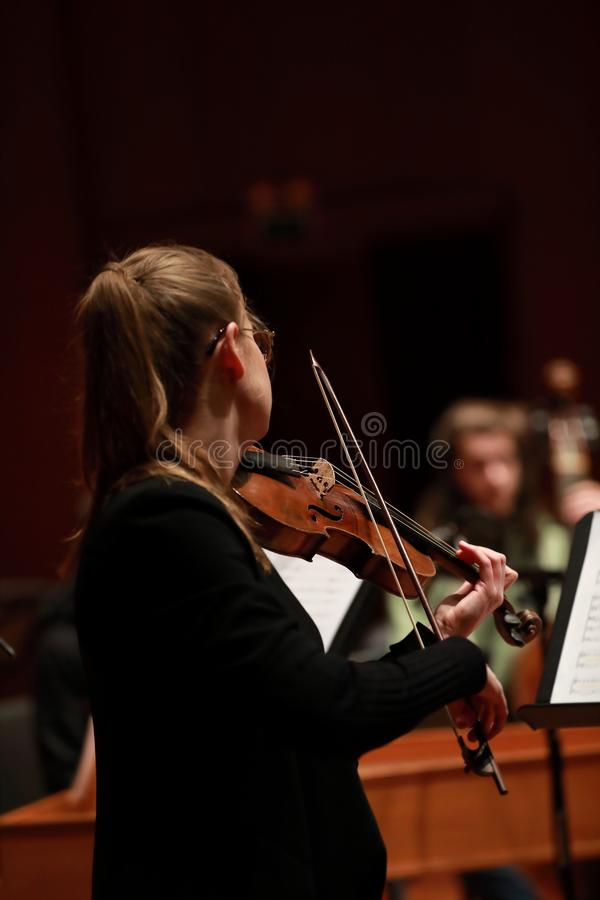 Classical music. Violinists in concert. Stringed, violinist.Closeup of musician playing the violin during a symphony royalty free stock images