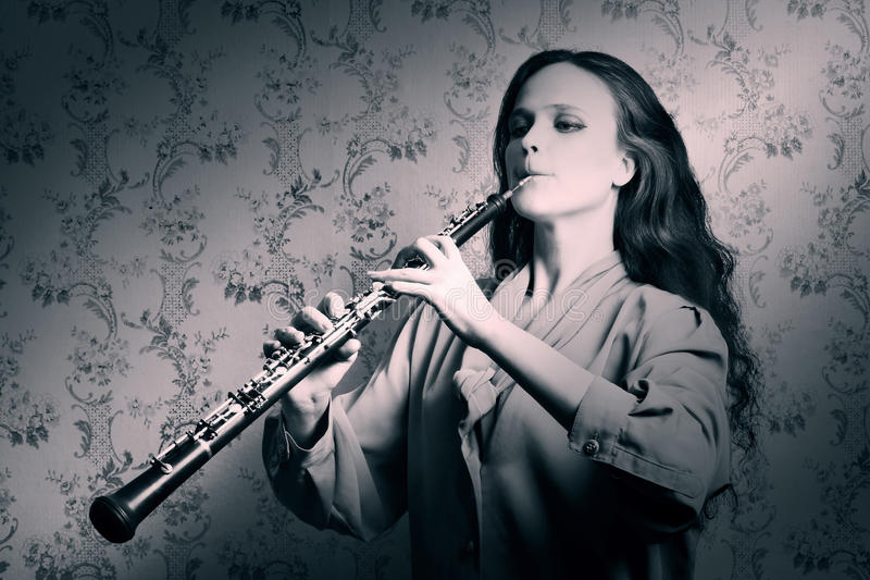 Classical musician oboe playing stock photo
