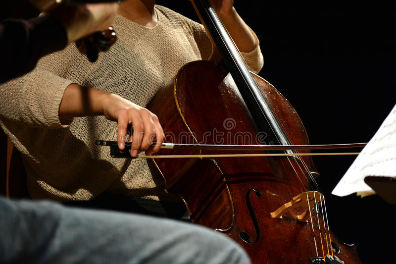 Classical musician playing the Cello during performance stock image