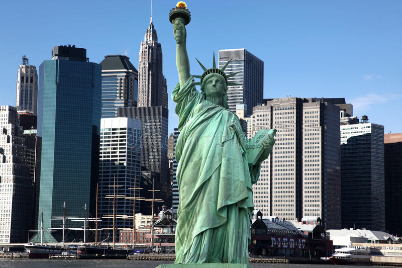 Classical NY - Statue Of Liberty vs Manhattan royalty free stock images