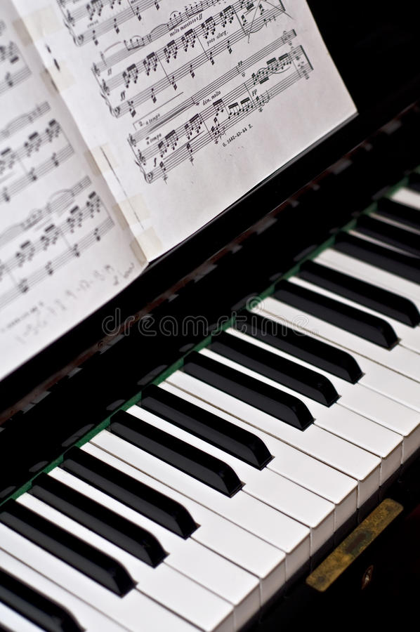 Classical piano. With sheet music stock images