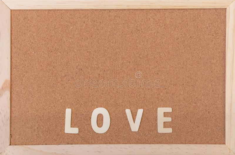 Classical plain brown cork board with wooden LOVE letter at bottom of frame stock images