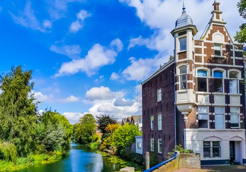 Classical residential building at the canal in dordrecht, The netherlands, vintage city architecture. A classical residential building at the canal in dordrecht stock photography