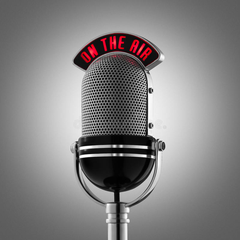 Classical retro microphone on the air on grey background stock photos