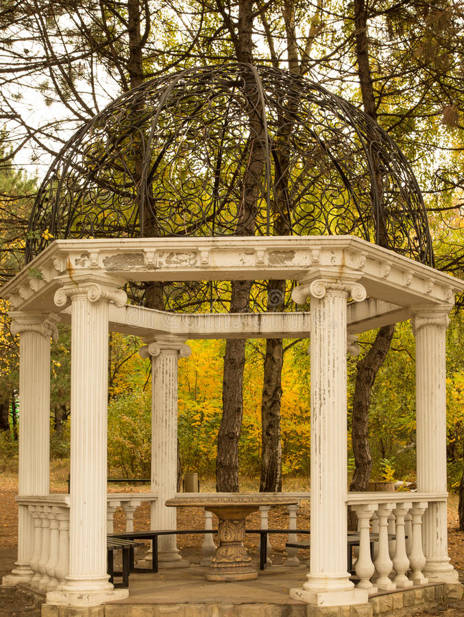 Classical rotunda with white columns in autumn park royalty free stock images