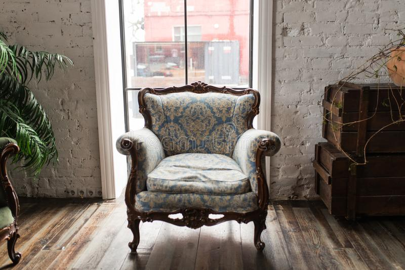 Classical style Armchair sofa couch in vintage room. Luxurious armchair vintage. Vintage royalty free stock image