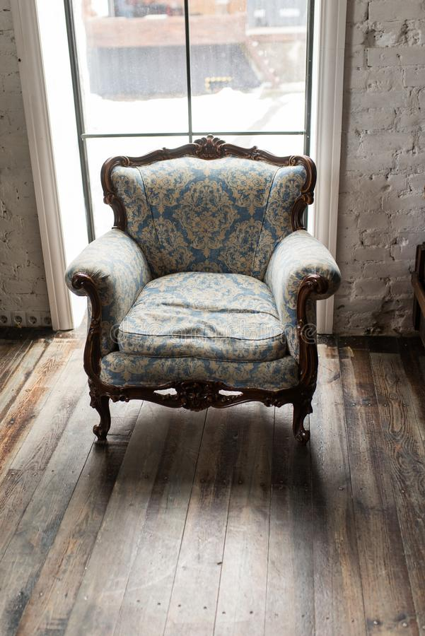 Classical style Armchair sofa couch in vintage room. Luxurious armchair vintage. Vintage stock image
