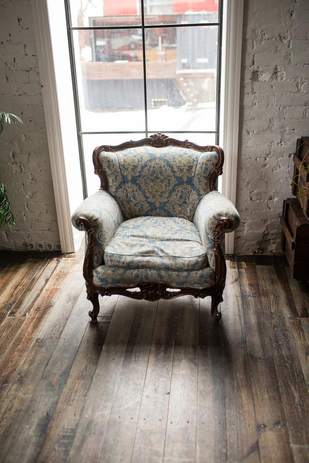 Classical style Armchair sofa couch in vintage room. Luxurious armchair vintage. Vintage stock images