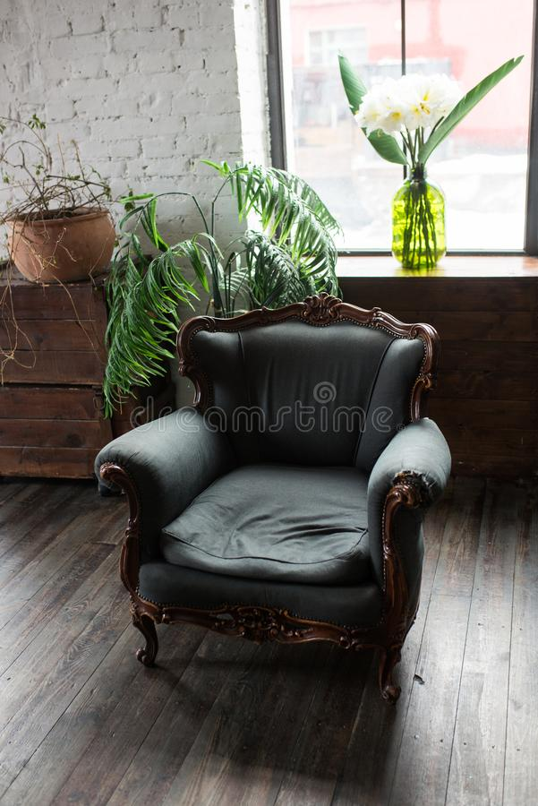 Classical style green Armchair sofa couch in vintage room. Luxurious armchair vintage. Vintage royalty free stock image