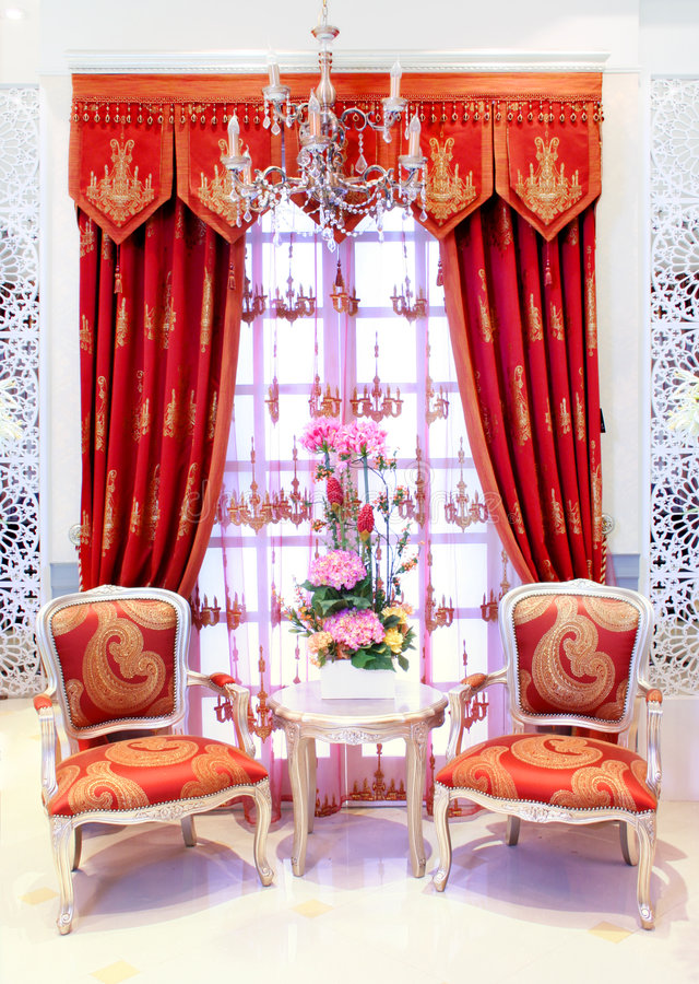 Classical stylish armchairs before window stock images