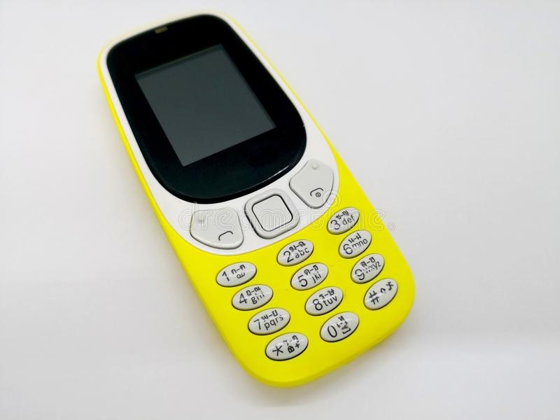 Classical yellow mobile phone. Communication concept. o royalty free stock photography