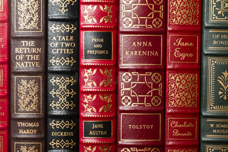 Classics of literature. In leather bound volumes on bookshelf - Dickens, Tolstoy, Hardy, Austen, Bronte, etc royalty free stock photos