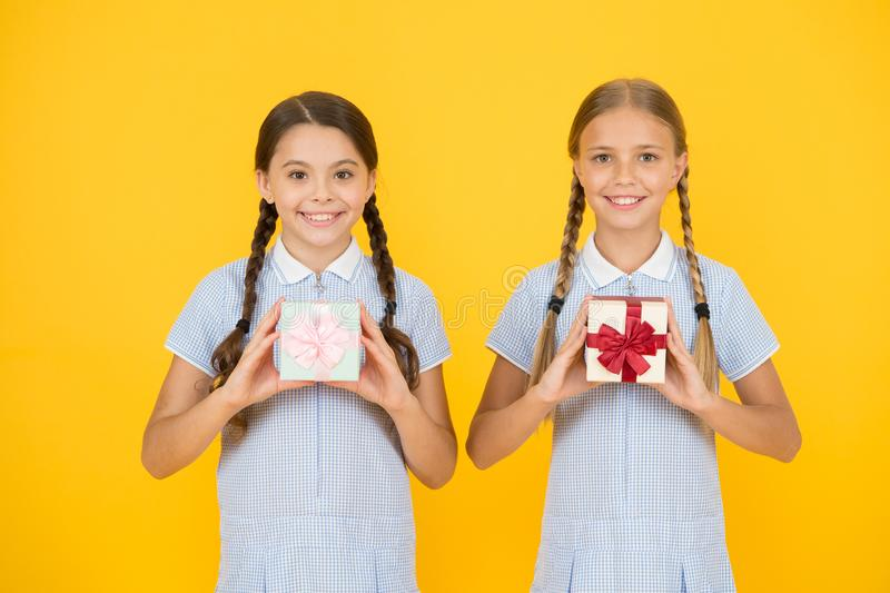 Classmates giving gifts boxes. Educational program for gifted kids. School holiday. Upbringing generosity. Share stock photo