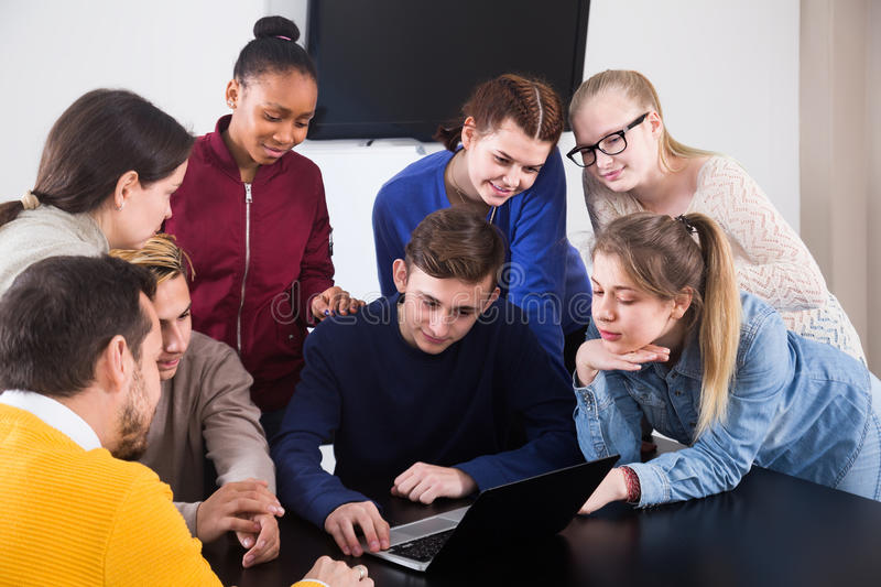 Classmates having difficult project to complete during class royalty free stock photo