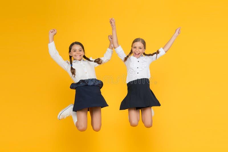 Classmates having fun at school Friends adorable pupils. Schoolgirls formal style perfect school uniform. Happy stock photos