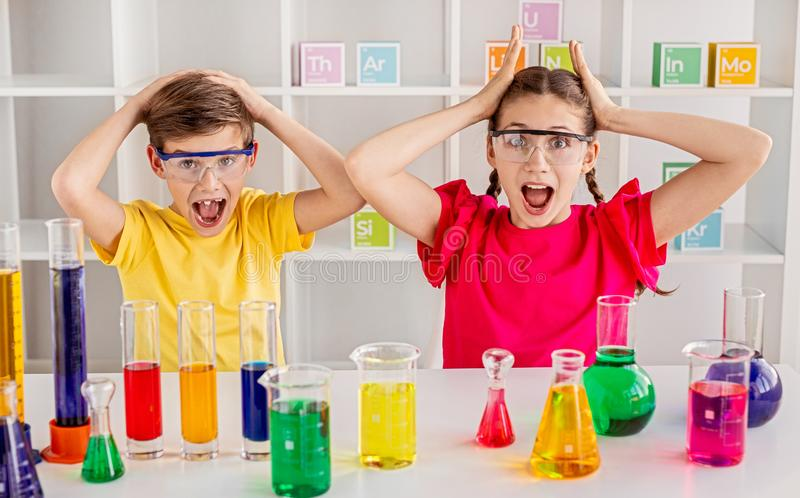 Classmates screaming during chemistry lesson stock image