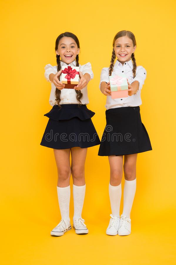 Classmates tidy pupils open gifts boxes. Educational program for gifted kids. Best pupils award. Holiday celebration stock images