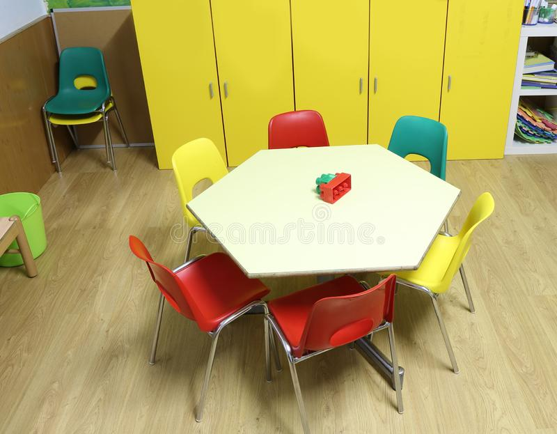 Classroom with chairs and the hexagonal child-friendly table stock images