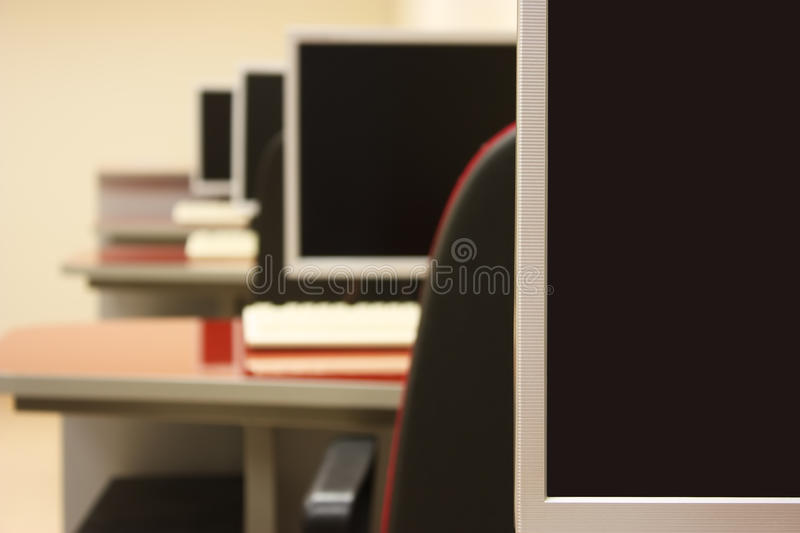 Classroom computer. Empty computer classroom with monitors royalty free stock images