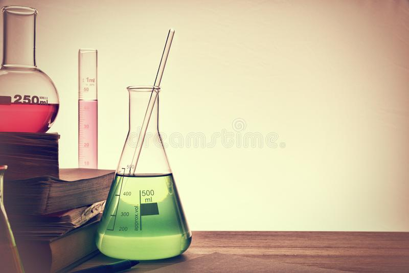 Classroom desk of chemistry teaching close up. Classroom desk of chemistry teaching with books and instruments. Chemical sciences education concept. Horizontal royalty free stock photography