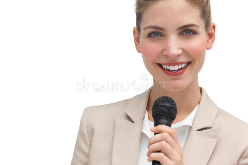 Classy businesswoman holding microphone stock photography