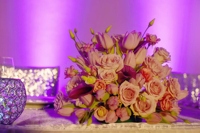Classy floral arrangement in a pastel pink hues bouquet featuring pink roses, tulips and fuchsia calla lilies stock photography