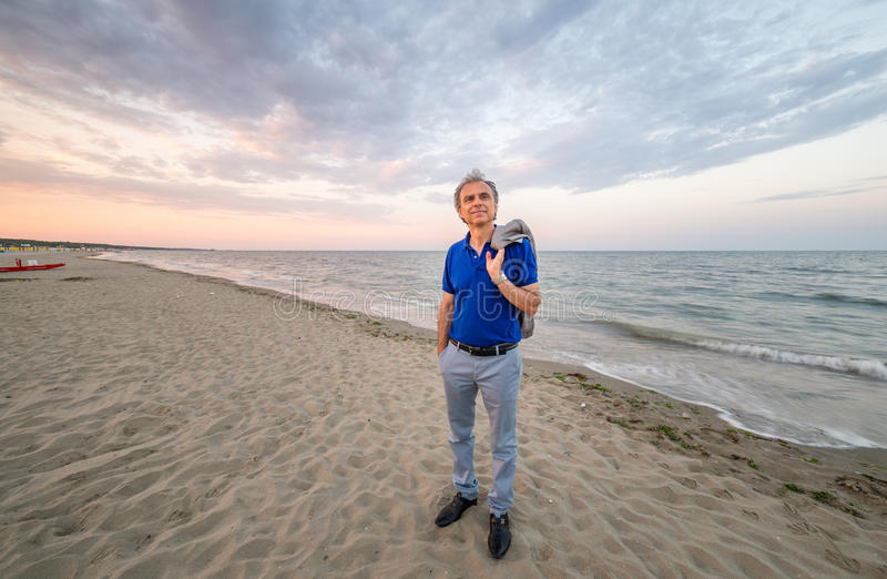 Classy mature man on seaside stock photography